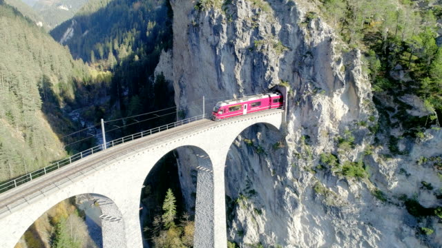 landwasser viaduct tunnel on bernina pass glacier express in switzerland - bridge built structure stock videos & royalty-free footage