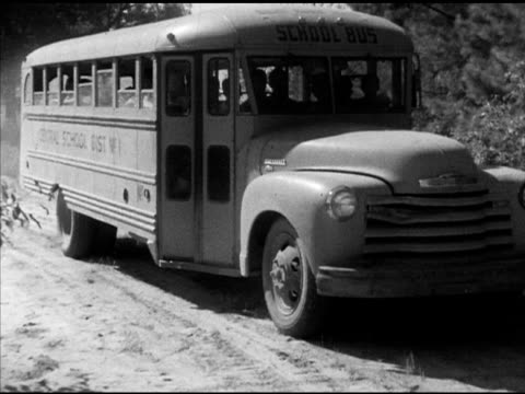 Laneburg HS students arriving on school bus at 'Laneburg School Forest' entering forest some carrying books Arkansas AR Nevada County