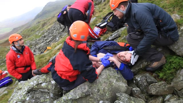 langdale/ambleside mountain rescue team members doing first aid training using members of the casualties union, ambleside, lake district, uk. - volunteer stock videos & royalty-free footage