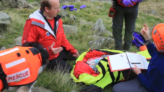 Langdale/Ambleside Mountain Rescue Team members doing first aid training using members of the casualties union, Ambleside, Lake District, UK.