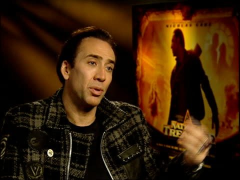 Langford asking question and Cage listening Nicolas Cage interview SOT Have to give yourself over to the reality of the movie which is a farfetched...