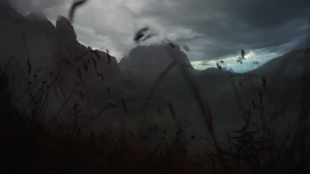 langkofel or sassolungo during a terrible weather foggy sunset - langkofel stock videos & royalty-free footage