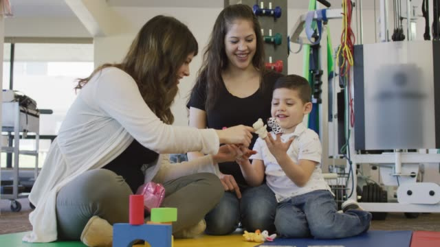 language speech pathologist and a hispanic boy using finger puppets - adult stock videos & royalty-free footage