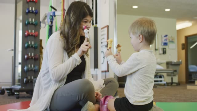 language speech pathologist  and young by playing with finger puppets - pathologist stock videos and b-roll footage