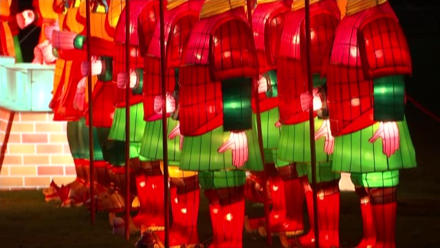 lantern festival starts in chiswick for chinese new year england london chiswick park illuminated dragon lantern tilt up chinese soldier lanterns lit... - chinesisches laternenfest stock-videos und b-roll-filmmaterial