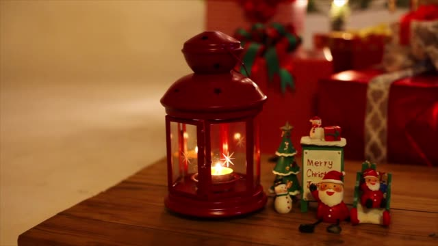 4k: lantern with candle hanging - christmas decore candle stock videos & royalty-free footage
