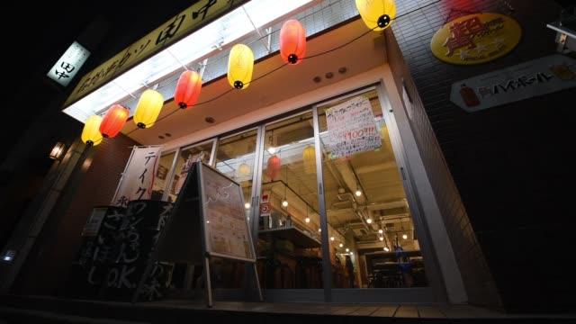 lanterns hang outside a kushikatsu tanaka restaurant operated by kushikatsu tanaka co in tokyo japan on thursday april 20 a man exits a kushikatsu... - breaded stock videos and b-roll footage