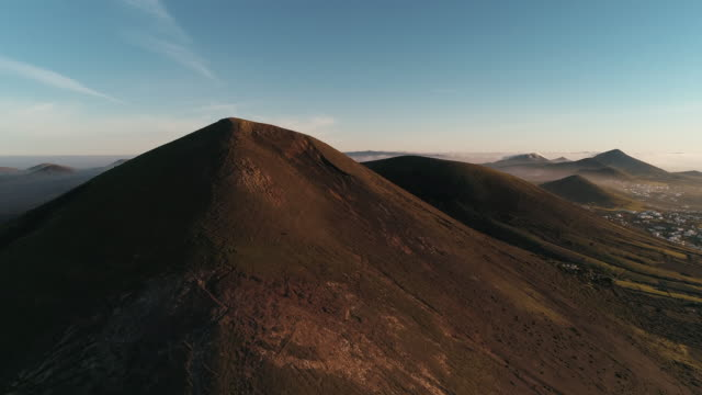 lanzarote volcanos seen from a rising up aerial shot, spain - horizontal stock videos & royalty-free footage