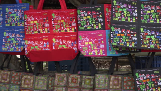 zo / lao bags with traditional motives at souvenir shop - shopping bag stock videos & royalty-free footage