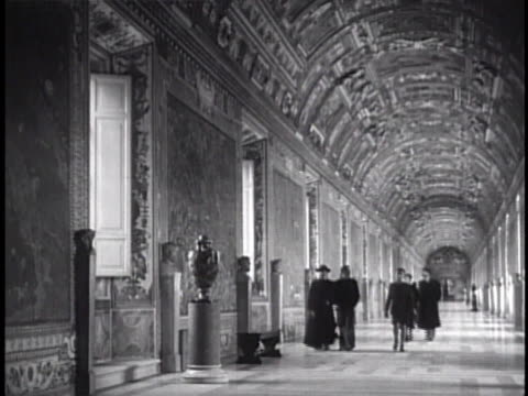 laocoon and his sons statue in gallery people walking in gallery of maps swiss guard walking by columns in sunlit hallway - priest stock videos and b-roll footage