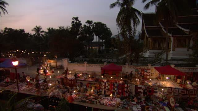 WS HA PAN Laos street market at dusk, Laos