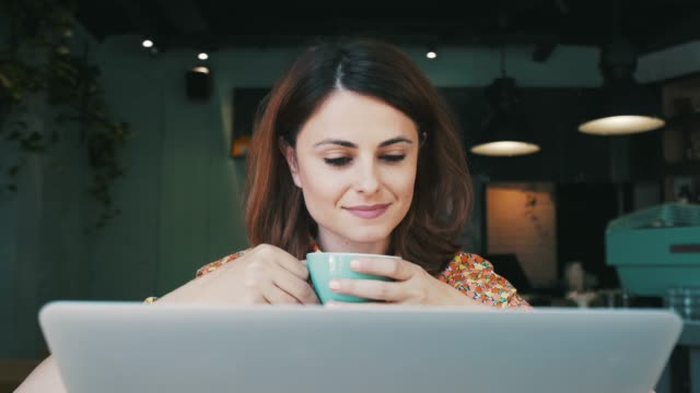 laptop and coffee. - serene people stock videos & royalty-free footage