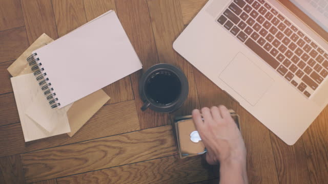 Laptop and Coffee with Office Supplies on Wood