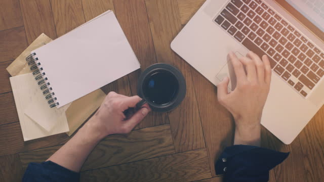 laptop and coffee with office supplies on wood - working from home stock videos and b-roll footage