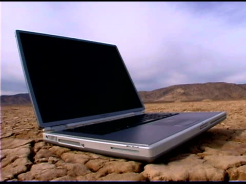 laptop computer in desert - durability stock videos and b-roll footage