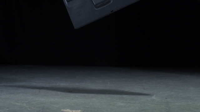 vídeos y material grabado en eventos de stock de laptop crashing on the floor, slow motion-close up  - romper