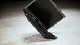 SLO MO LD Laptop hitting the floor