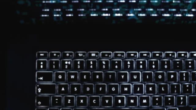 laptop keypad backlit dolly shot. - electronics stock videos & royalty-free footage