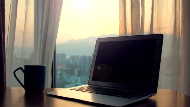 laptop on table with curtains floating - desk stock videos & royalty-free footage