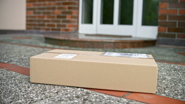 ds laptop package delivered and left on the doorstep during covid-19 pandemic lockdown - doorstep stock videos & royalty-free footage