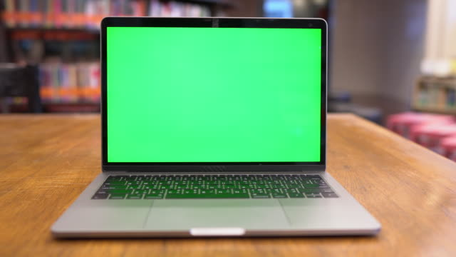 laptop with green screen in library, chroma key - wood material stock videos & royalty-free footage