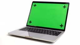 Laptop With Green Screen Rotate On White Background.