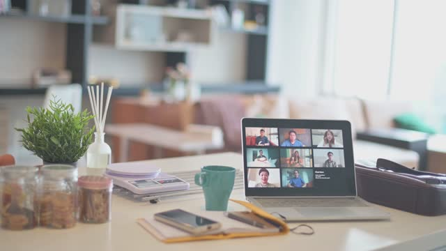 laptop with screen video conference on kitchen counter with smart phone , note pad - medium group of people stock videos & royalty-free footage