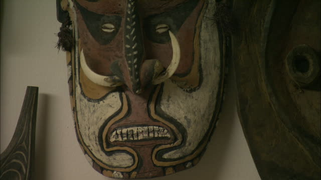 a large african mask hangs on a wall. - tradition stock videos & royalty-free footage