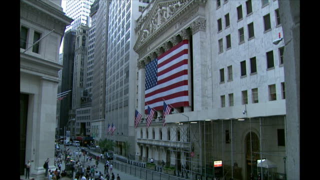 large american flag on the side of the new york stock exchange building - 2008 stock videos & royalty-free footage