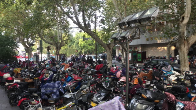 large amounts of electrical bikes park on the street in yangzhou china is now the no1 ebike manufacturing buying and exporting country - parking stock videos & royalty-free footage