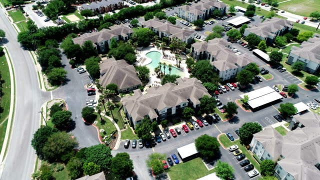 large apartment condo suburb new development living looking down from high above drone view - house rental stock videos & royalty-free footage