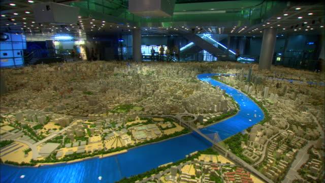 ws large architectural model of city of shanghai in year 2020 on display at shanghai urban planning museum, shanghai, china - レプリカ点の映像素材/bロール
