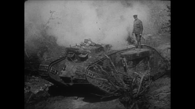 vidéos et rushes de large artillery gun firing, explosion on distant hilltop, guns firing from bunkers, british tank moving on battlefield with officer standing on top,... - première guerre mondiale