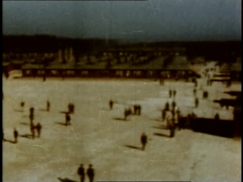 large assembly area with spotlights surrounding it / buchenwald weimar thuringia germany - campo di concentramento di buchenwald video stock e b–roll