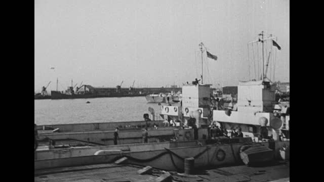 large assortment of ships at dock in preparation for the invasion / for a 'christening', african-american men hammer at blocks and an lci launches... - amphibious vehicle stock videos & royalty-free footage