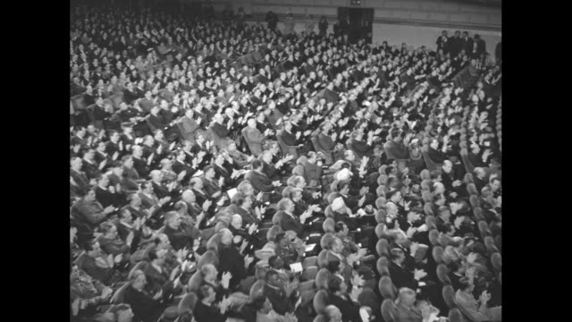 vídeos de stock e filmes b-roll de vs large audience applauding / black men and a black woman in audience one man in military uniform / british foreign minister anthony eden with... - edward stettinius