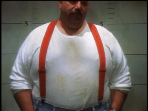 pan portrait large bald man with mustache + wearing suspenders standing in police lineup - suspenders stock videos and b-roll footage