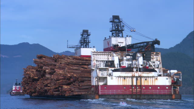 MS, Large barge loaded with timber logs, Gibsons, British Columbia, Canada