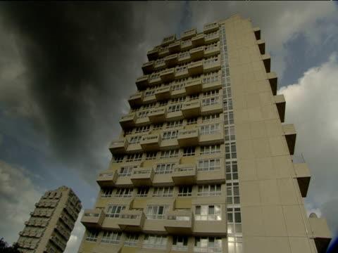 Large black cloud hangs over high rise tower blocks London