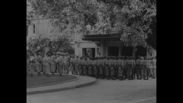 a large black sedan comes to a stop in the courtyard of malacanang palace gen douglas macarthur and filipino president sergio osmena exit and walk to... - douglas macarthur stock videos and b-roll footage