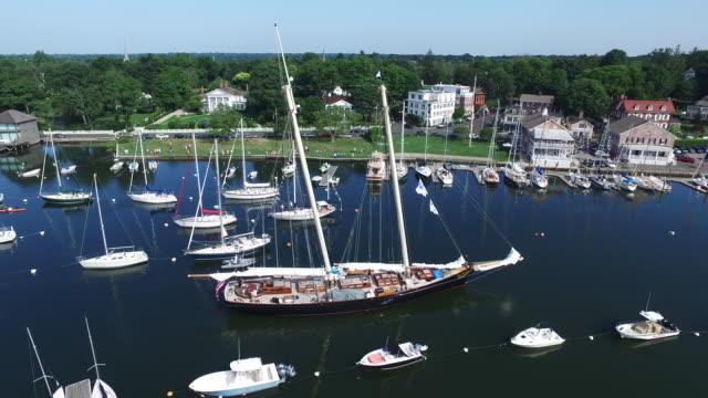 large boat manuevering around smaller boats - connecticut bildbanksvideor och videomaterial från bakom kulisserna