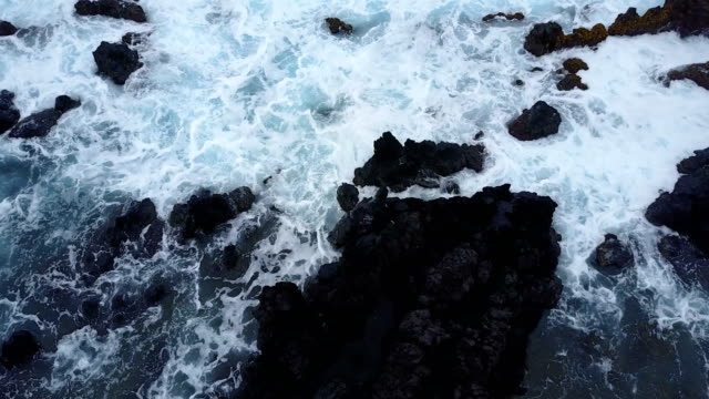 Large Boulder on Rocky Beach with Waves Crashing