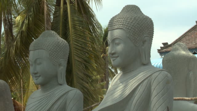 large buddha stone statues in san tok, cambodia - effigy stock videos & royalty-free footage