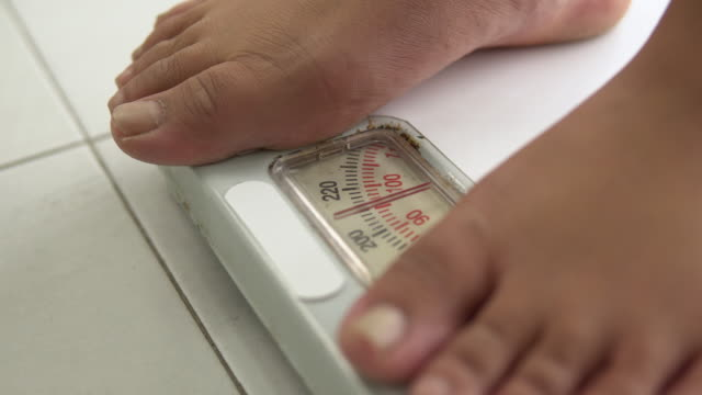 large build asian woman and Body Weight scale