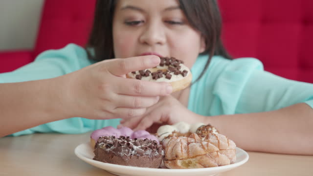 large build woman - unhealthy eating stock videos & royalty-free footage