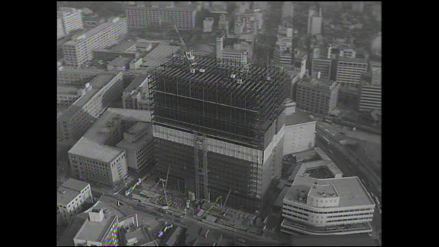 a large building is under construction in tokyo-to chiyodaku, japan. - showa period stock videos & royalty-free footage
