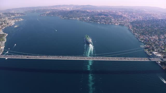 large bulk carrier passing in the bosphorus - aerial view - international landmark stock videos & royalty-free footage