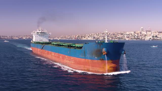 large bulk carrier passing in the bosphorus - aerial view - bosphorus stock videos & royalty-free footage
