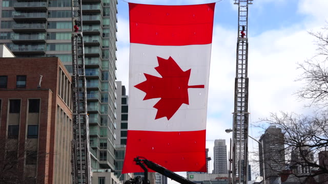 Large Canadian Flag above Bloor Street The event is also known as the Feast of Saint Patrick is a cultural and religious celebration around 17 March...