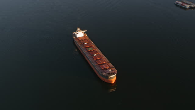 AERIAL Large cargo ship sailing the sea in morning sun